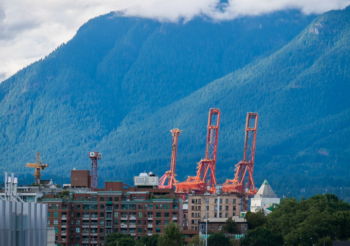 Vancouver harbour cranes and North Shore mountains