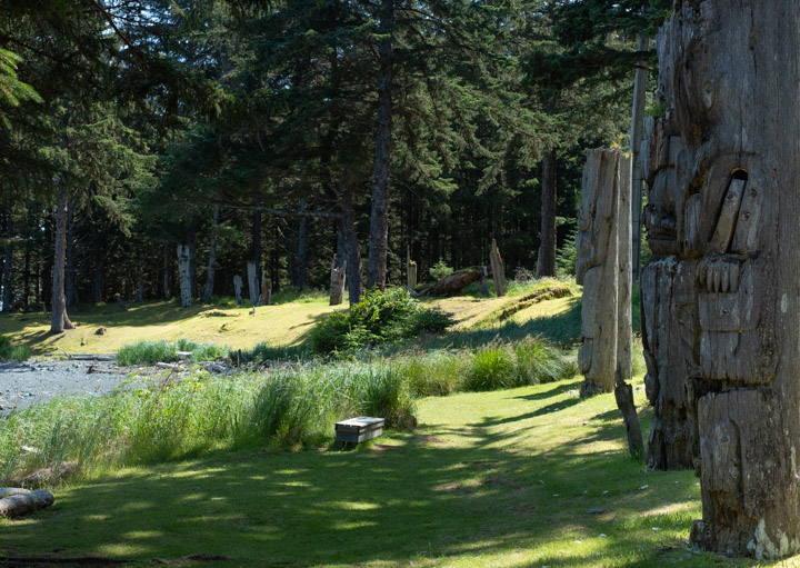 Standing totems at the SG̱ang Gwaay village site in Gwaii Haaans