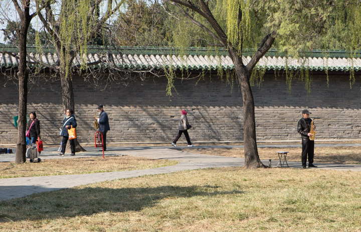 Saxophonists practice in the Temple of Heaven park, Beijing