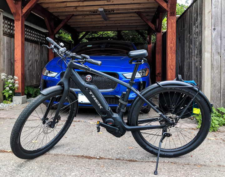 Trek Commuter+ 7 e-bike and Jaguar I-Pace electric car