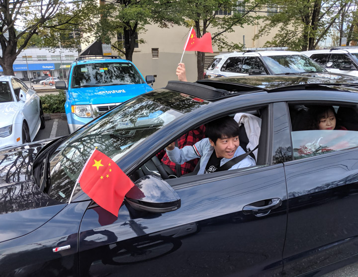 Pro-Beijing demonstrators in expensive cars